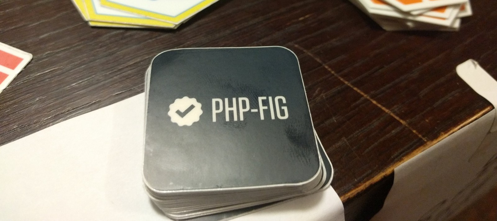 PHP-FIG stickers, shared at the PHPDay front desk